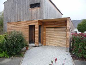 Garage ossature bois en mélèze avec accès maison