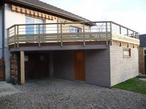 Un sous-sol + une terrasse, bardage pré-grisaillé
